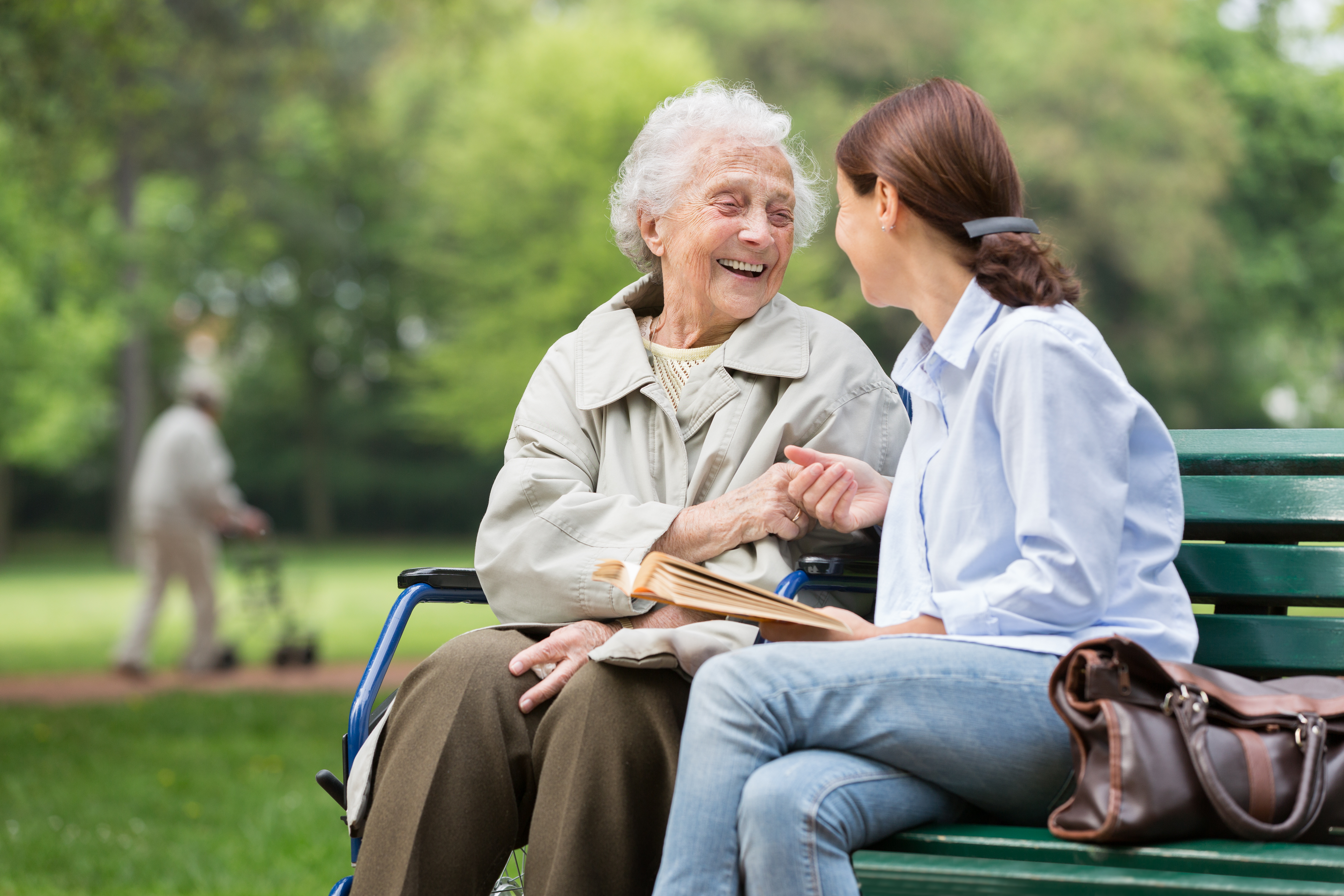Senior woman with caregiver in the park