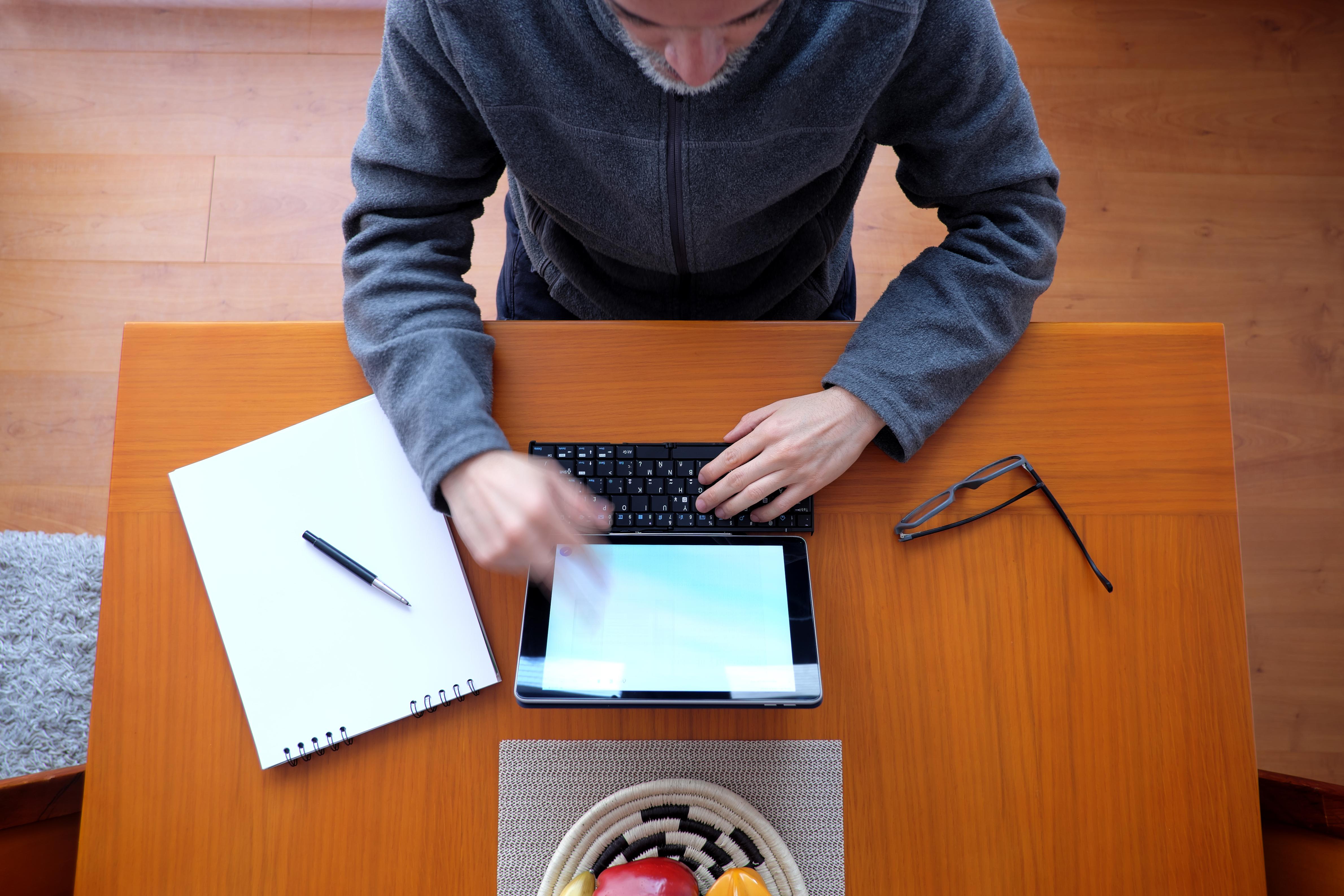 man sitting working at home