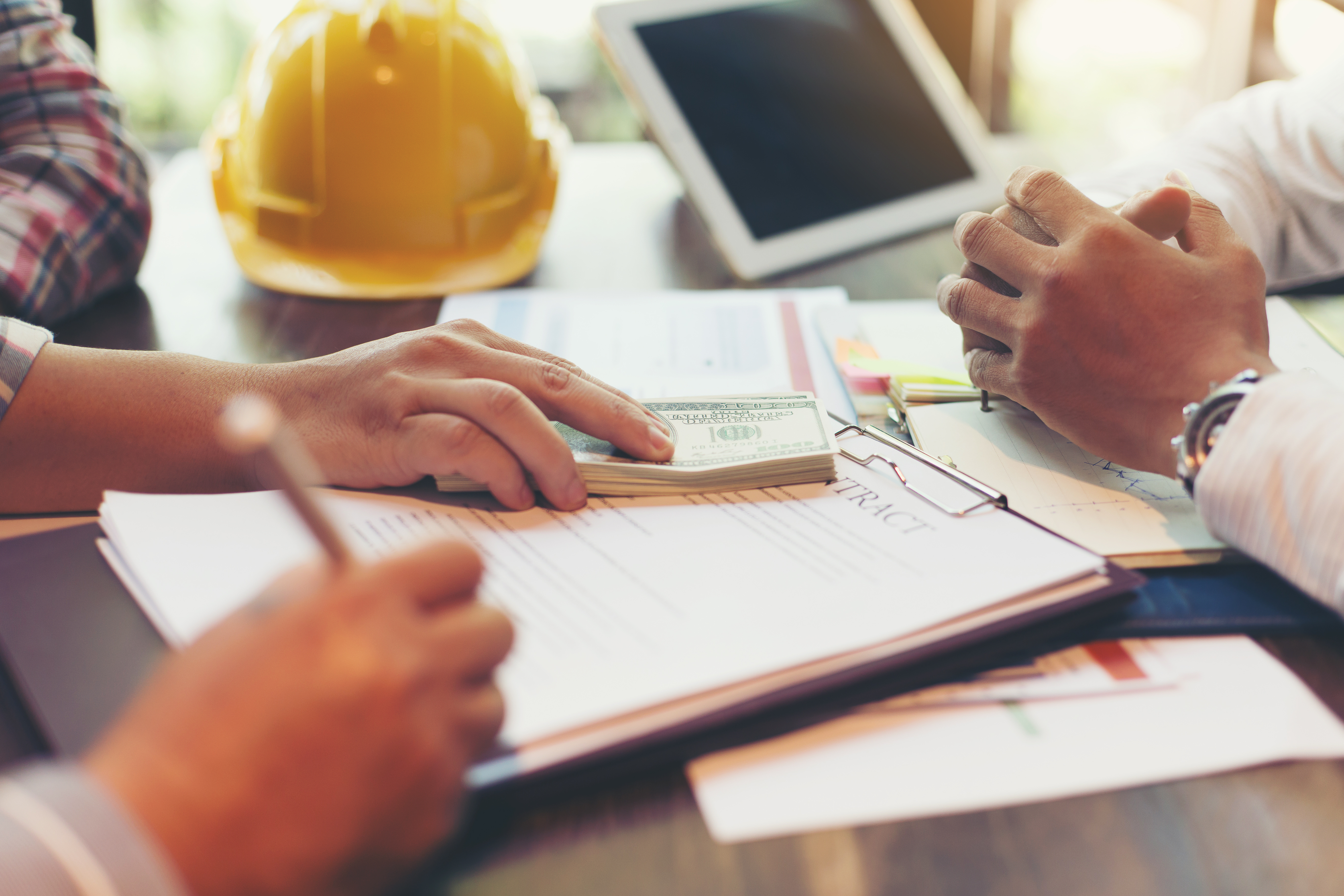 signing a contract for construction