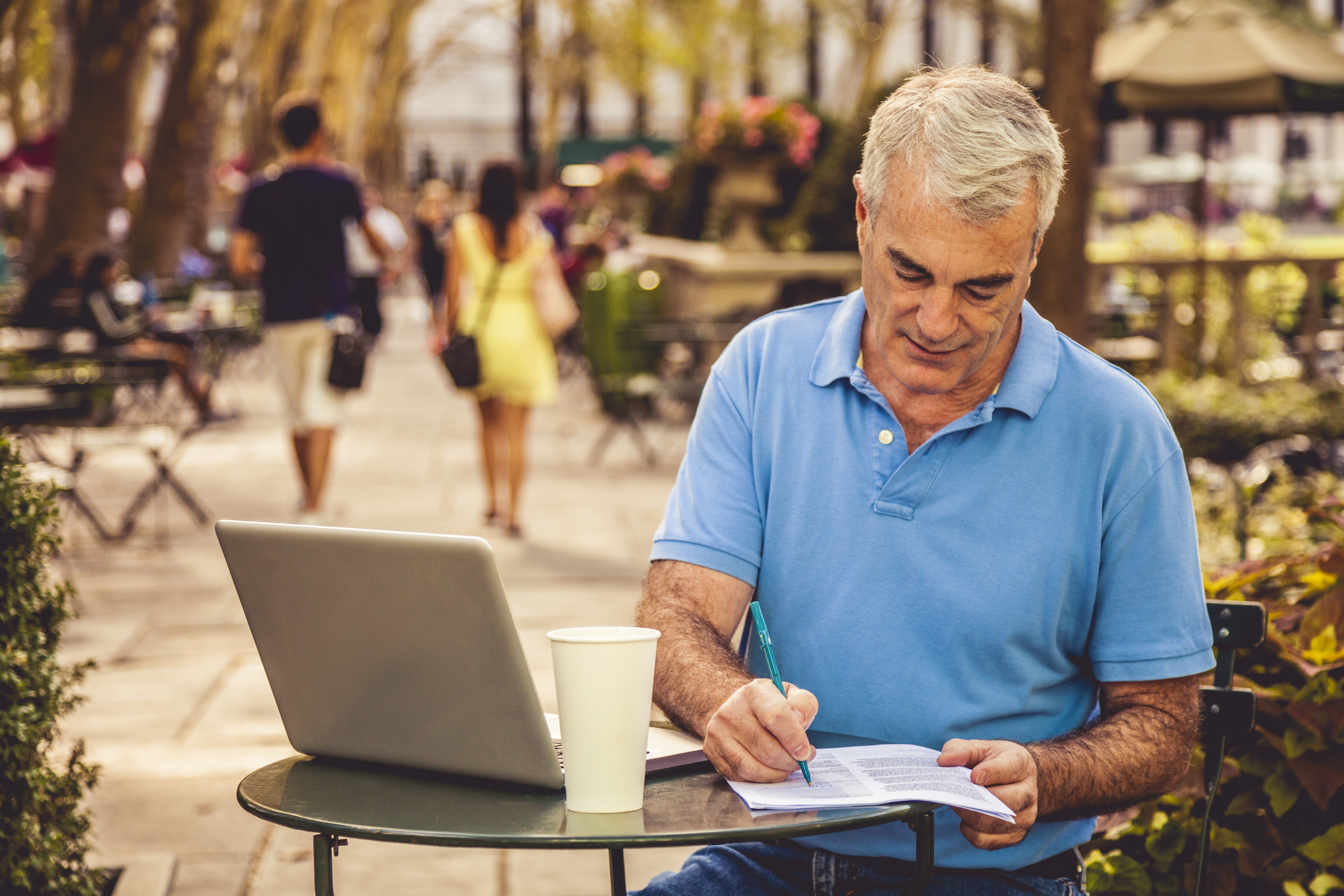 Man filling documents in a public area in New York