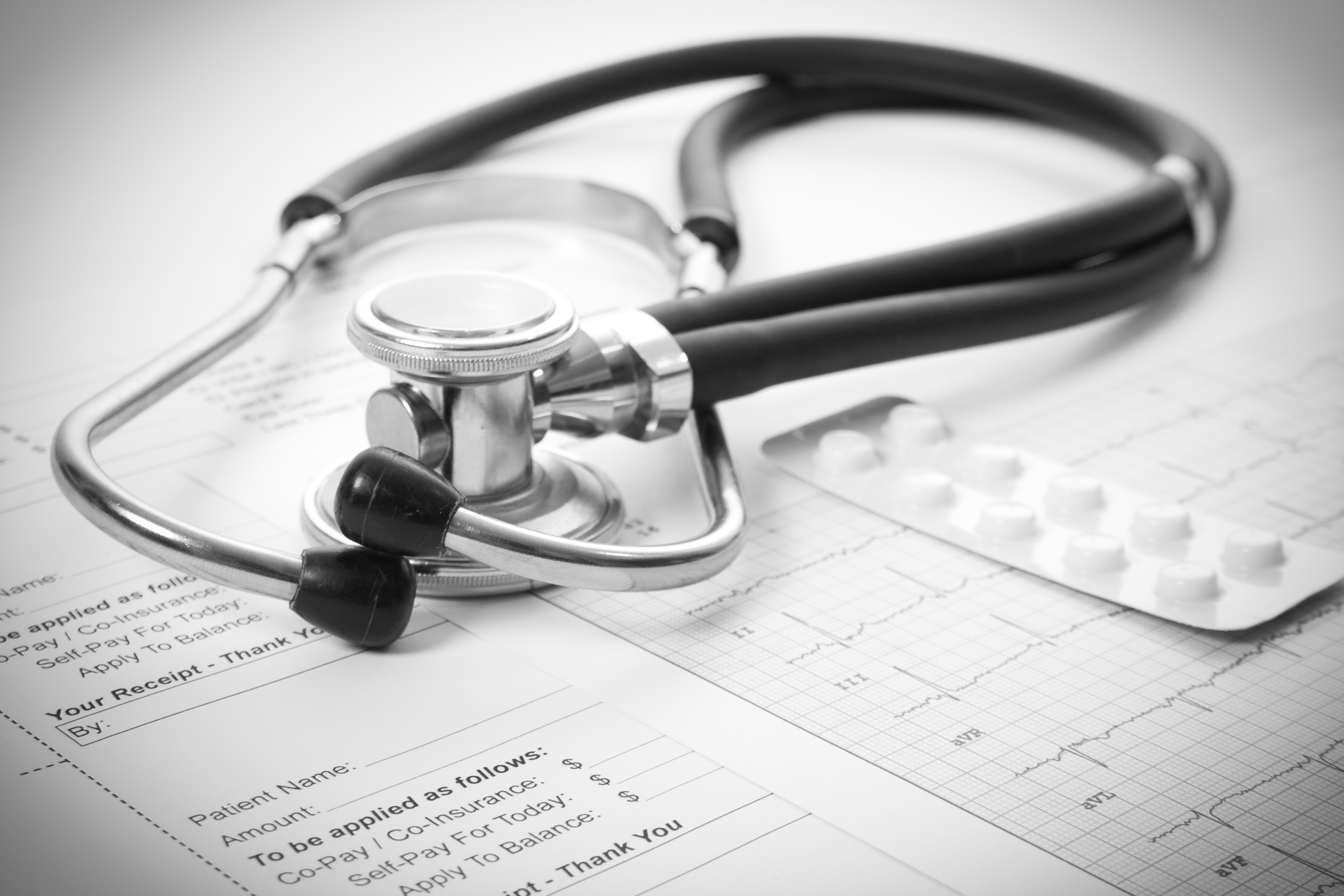 Sthetoscope, EKG and pills
