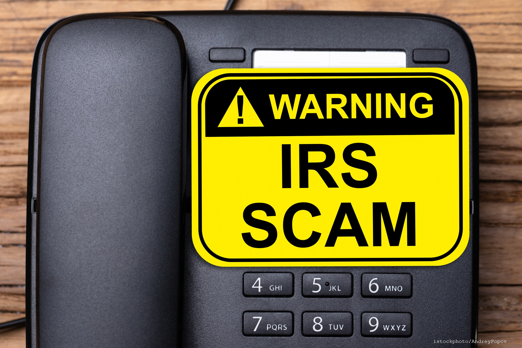 IRS Scam Warning Sign On Landline Phone
