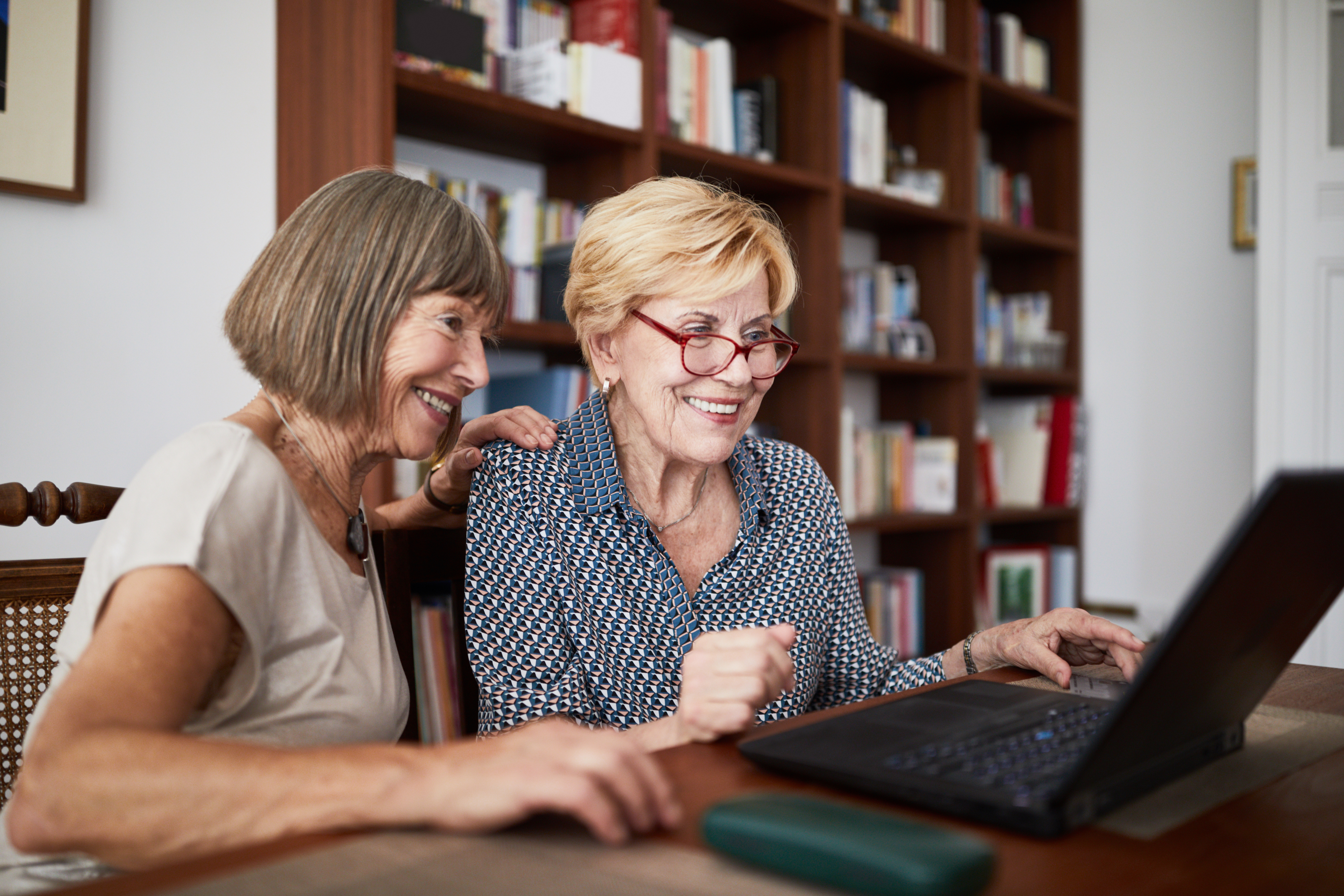 Senior friends doing shopping online