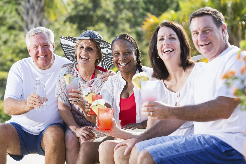 Mature adults enjoying tropical drinks