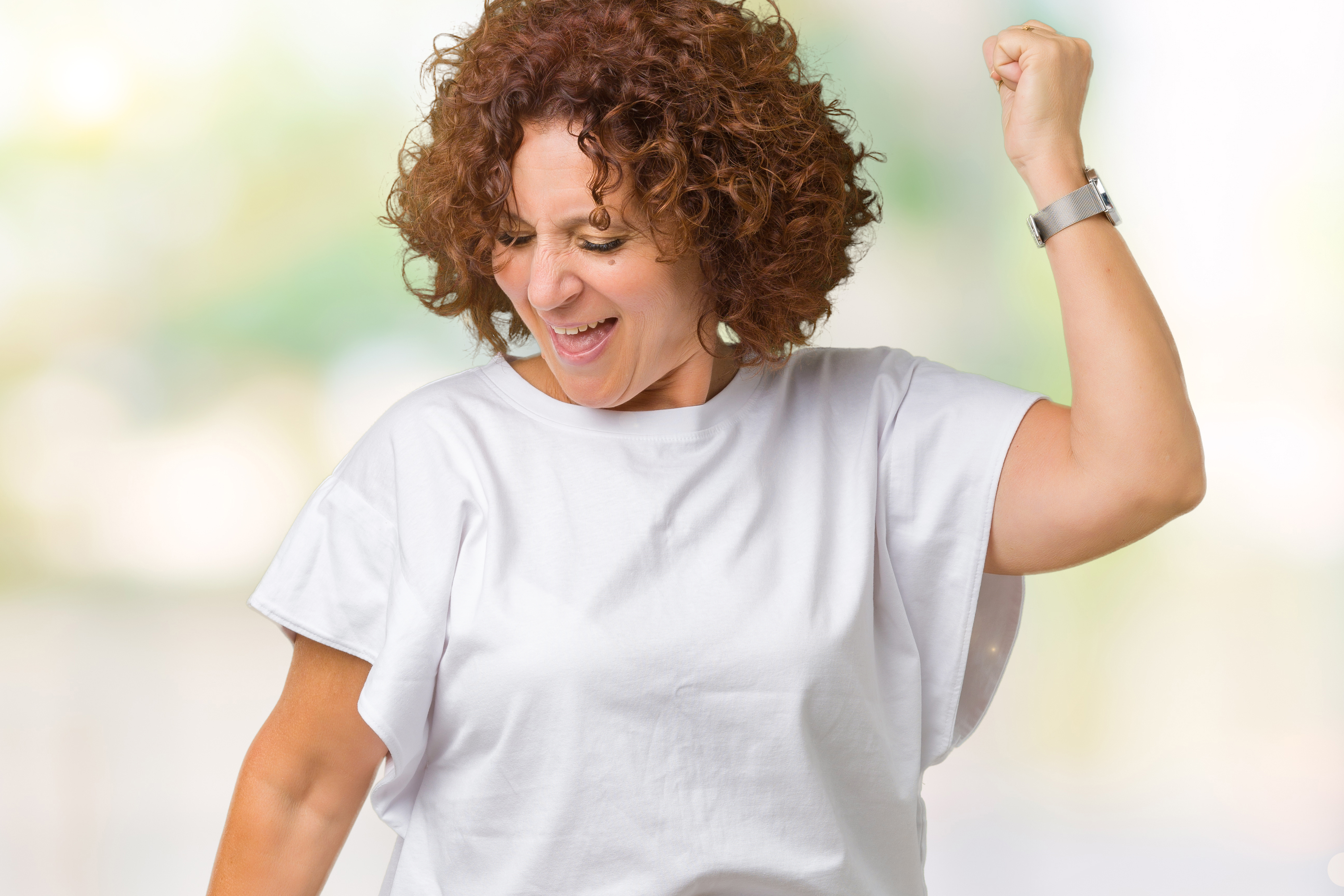 Beautiful middle ager senior woman wearing white t-shirt over isolated background Dancing happy and cheerful, smiling moving casual and confident listening to music