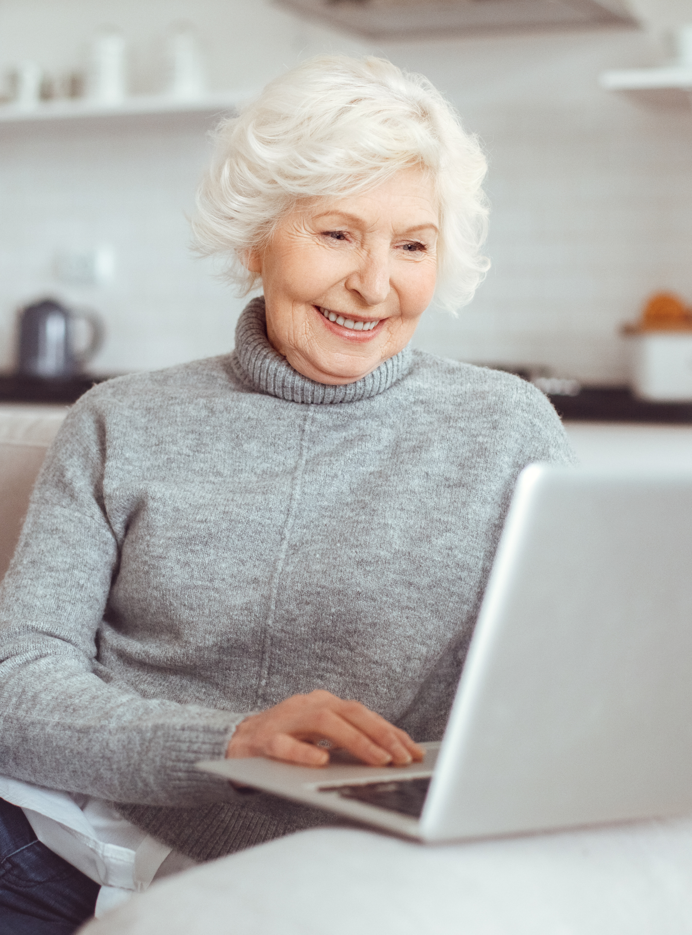 Grandma learns how to work with a computer at home