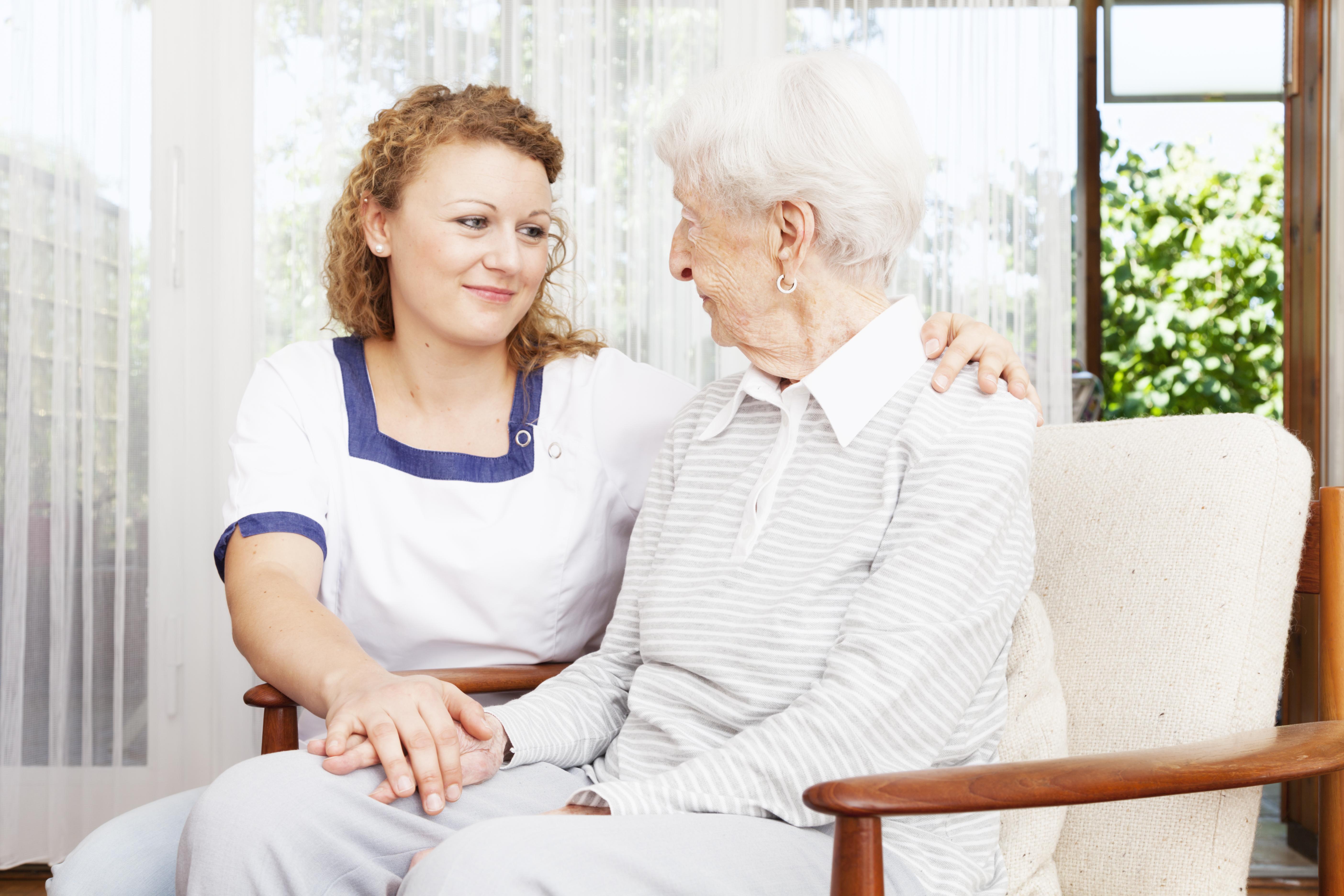 senior woman and caregiver togetherness