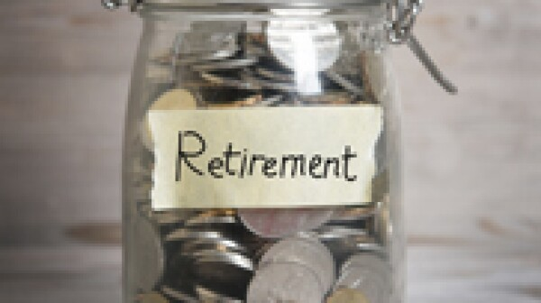 Money jar with retirement label.