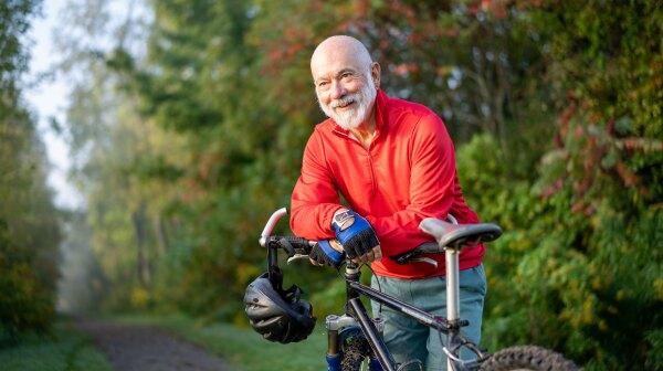 An older man on a bike