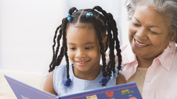 African grandmother and granddaughter reading
