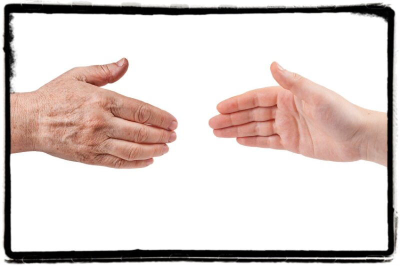 Old hand reaching to young hand_border added__denisovd_499,998
