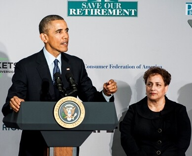 AARP President Jo Ann Jenkins look on as President Barack Obama gives a speech on new rules requiring financial advisers to always act in the best interest of their clients at AARP headquarters in Washington, D.C. on February 23, 2015.