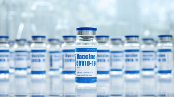 Covid 19 corona virus vaccine vial bottles for intramuscular injections on medical pharmaceutical industry background. Coronavirus cure manufacture, flu treatment drug pharmacy production concept.