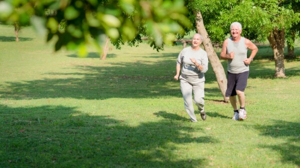 Active senior people jogging in city park