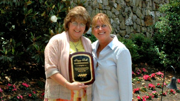 "AARP Kentucky Associate State Director of Advocacy Cathy Allgood Murphy presented Roll the award during the Annual Lexington Summer Series on Aging at the KAG Award Luncheon. Roll accepted the award saying, ""I believe no one can better tell lawmakers what seniors need most than seniors themselves. Our seniors don't mind you fighting for them, but they want to fight for themselves, too."""