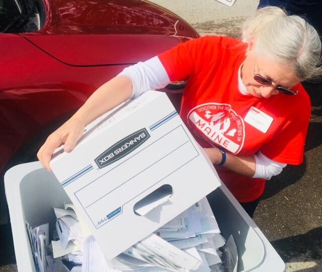 Volunteer Emptying a Bin Bangor