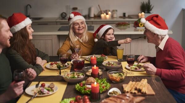 Joyful family having fun during festive dinner