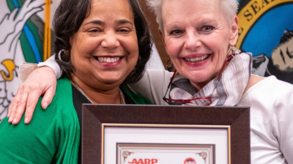 Tacoma Mayor Victoria Woodards and At-Large Council Member Lillian Hunter with age-friendly designation certificate.