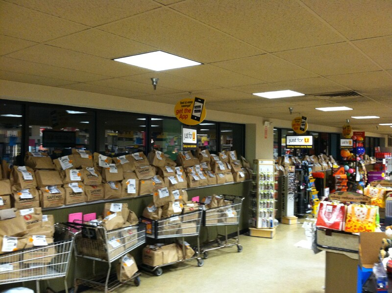 Donated grocery bags line the walls in a Safeway store in Jacksonville, MD