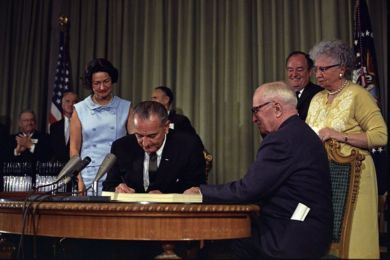 LBJ signs Medicare into law