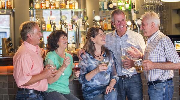 Happy Senior Friends in a Pub