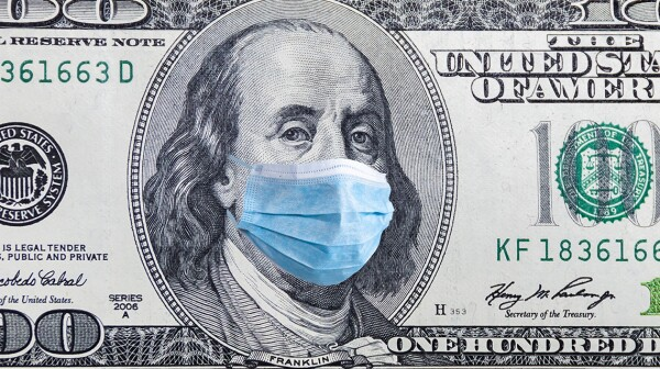 US quarantine, 100 dollar banknote with medical mask. The concept of epidemic and protection against coronavrius.