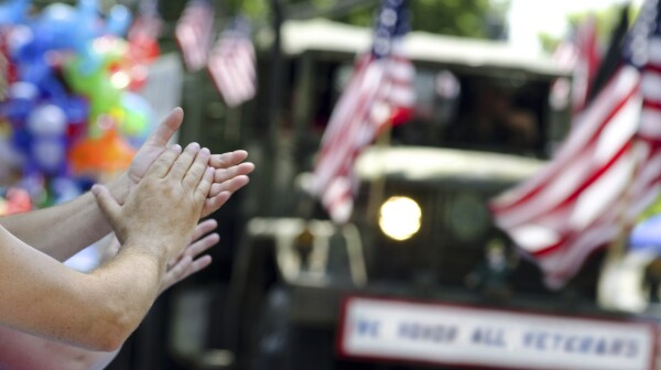 hands clapping at veterans parade