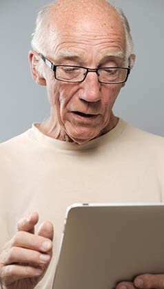 Senior Man with Tablet Computer