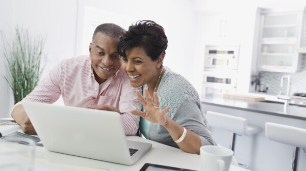 Husband and wife enjoying a video chat on laptop