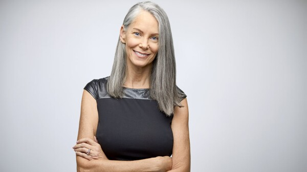 Portrait of confident mature businesswoman smiling