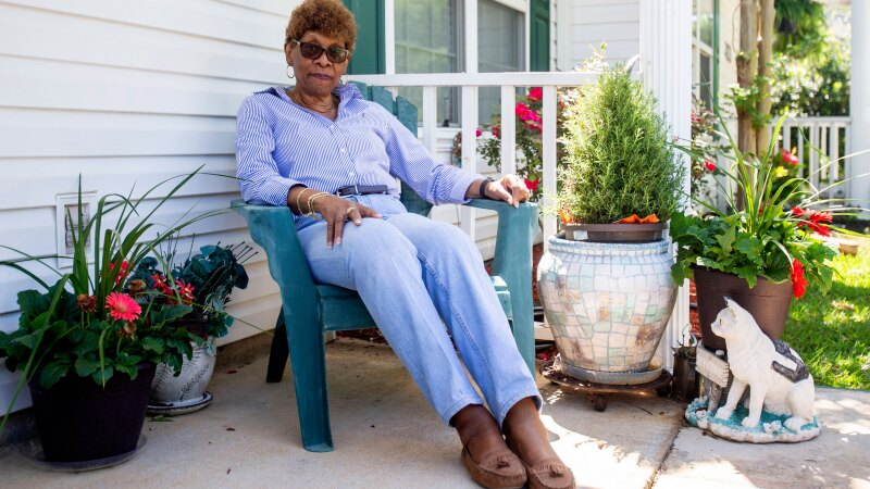A woman sitting on her porch