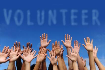 iStock_000016475829XSmall volunteer hands
