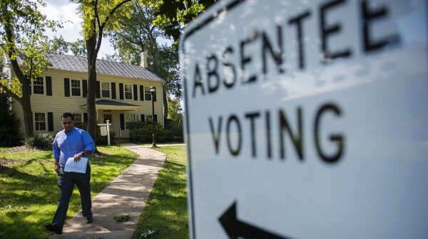 A man leaves a building where he cast an absentee ballot.