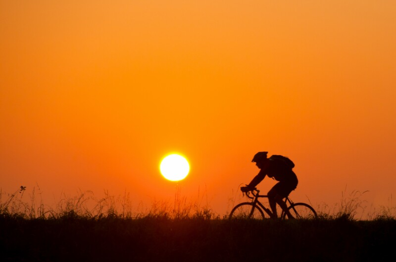 bicycle rider at sunset (sunrise)