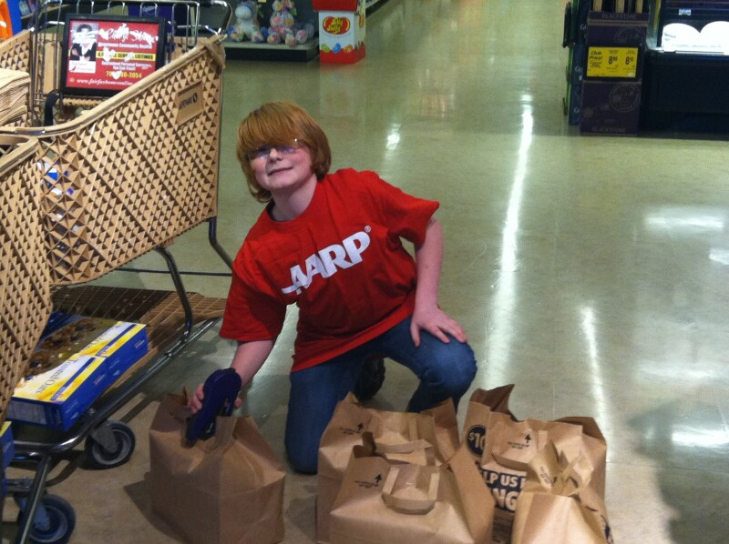 Kelly's 14-year-old neighbor offered to help encourage customers to donate at a local Safeway store in Alexandria, VA.