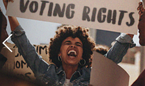 Black woman holding voting rights sign