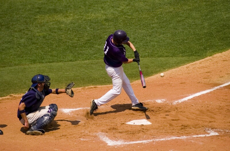 Baseball Swing as batter hits a pitched ball