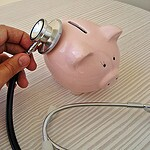 healthcare piggy bank from flickr creative commons credit 401(K) 2013
