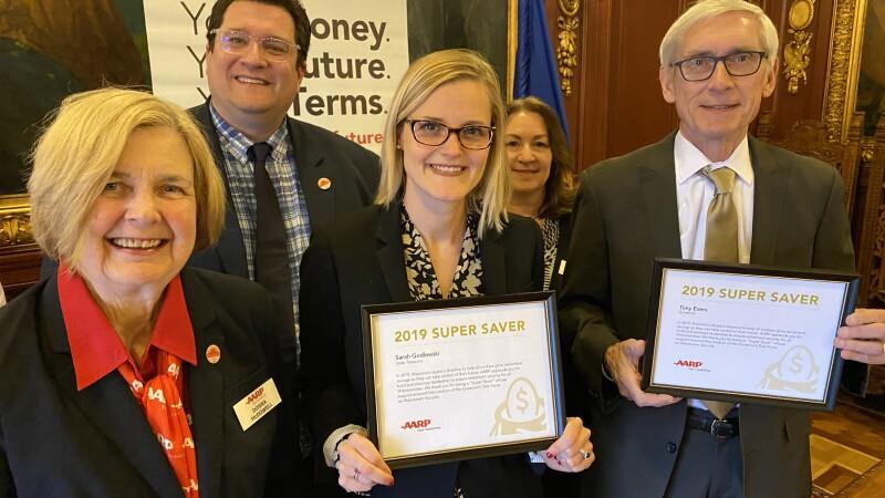 governor and treasuer with award.jpg