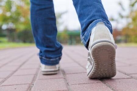 +-sneakered-feet-on-sidewalk-Blog-april-14-13409511_s