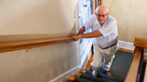 Elderly man climbing stairs_ Kali Nine LLC_sized for ET