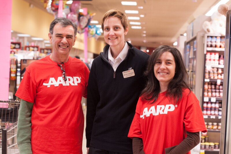 Aldo Asseo and Maria Ipoucha volunteer for AARP during the HfH Safeway food drive.