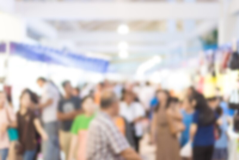 blurred image of exhibition show market product and crowd people
