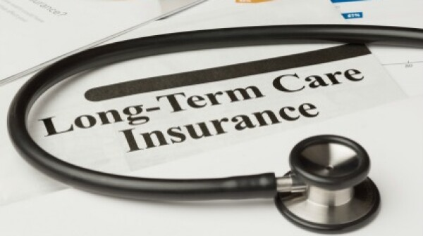 Long-term care insurance information, form and stethoscope.