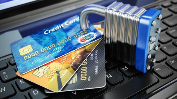 Internet security concept. Credit cards and lock on laptop keybo