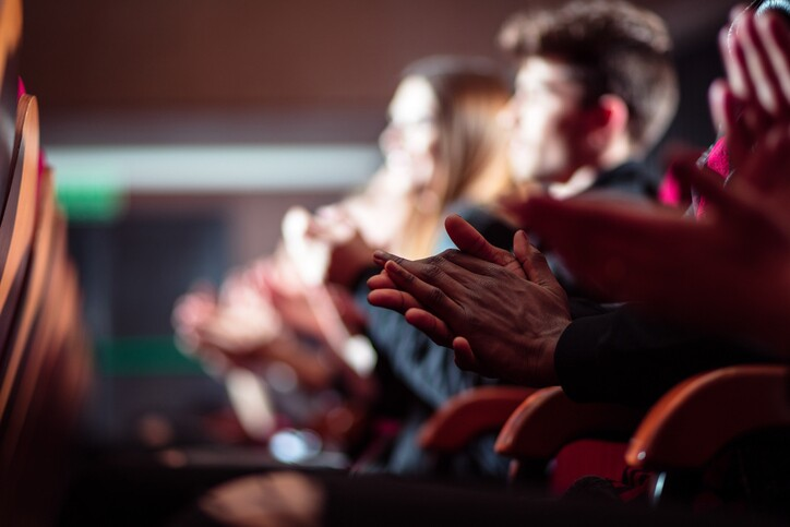 People in the theater, close up of clapping hands