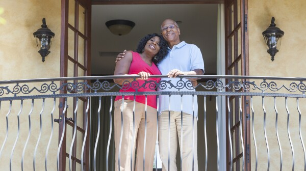 Senior African American Man & Woman Couple on Balcony