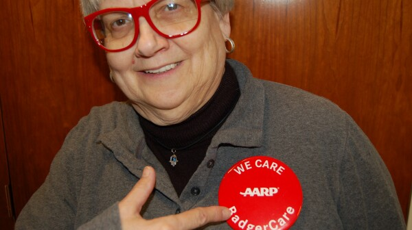 Helen Marks Dicks displays BadgerCare button
