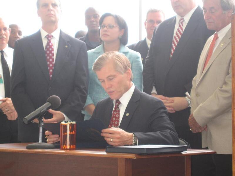 Governor Signing Bill