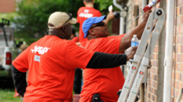 AARP volunteers helping restore a neighbor's home